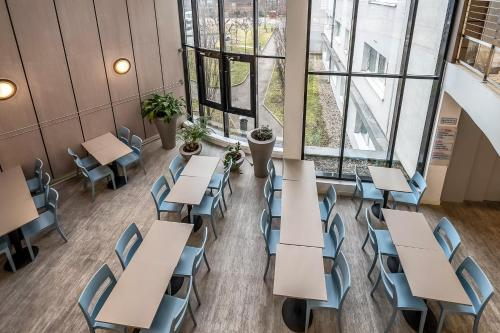 Restaurant ou autre lieu de restauration dans l'établissement Zenitude Hôtel-Résidences Les Hauts d'Annecy