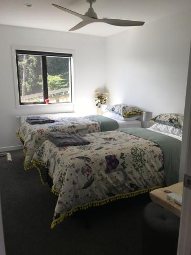 A bed or beds in a room at Little house on the hill