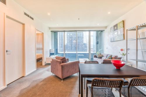 A seating area at CBD, Collins St address, near Southern Cross - 2 beds