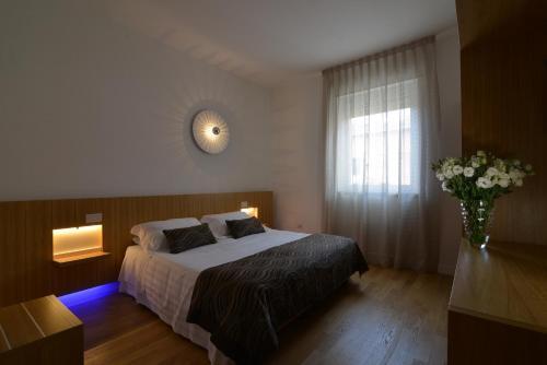 Letto o letti in una camera di Hotel San Domenico Al Piano