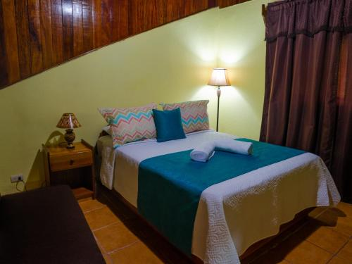 A bed or beds in a room at Catarata Eco Lodge
