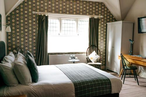A bed or beds in a room at Bridge Street House