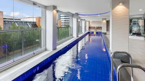 The swimming pool at or near Oaks Adelaide Embassy Suites