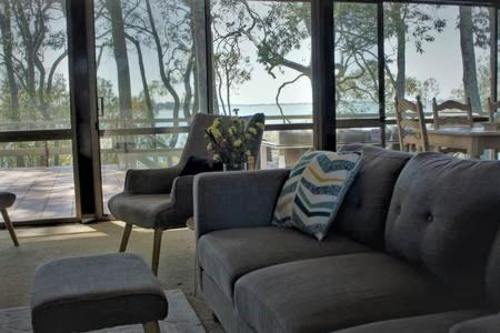 A seating area at Tuggerah Lake House - large luxury waterfront