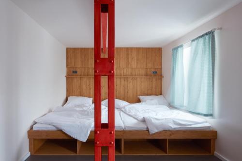 Ein Bett oder Betten in einem Zimmer der Unterkunft Pivovar Trautenberk