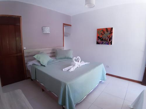 A bed or beds in a room at Pouso Atobá