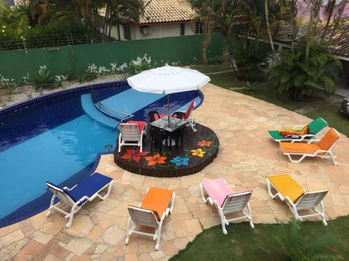 A view of the pool at Residencial Ohana Porto Seguro or nearby