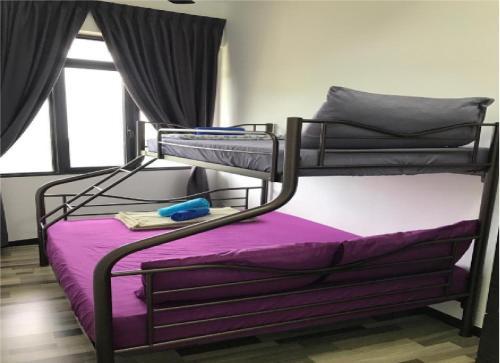 A bunk bed or bunk beds in a room at ARTE S 3B-33-03A Cozy SeaView Max 4paxs