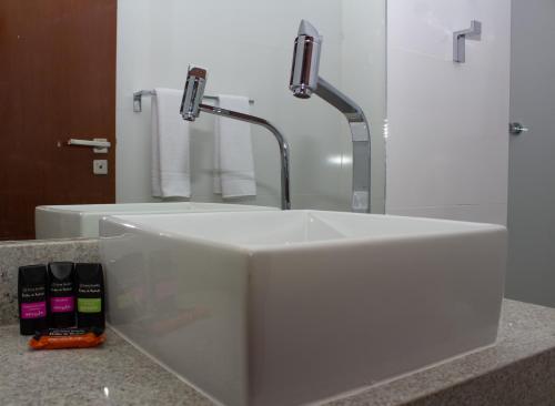 Um banheiro em Bella Vida Suites e Apartamentos