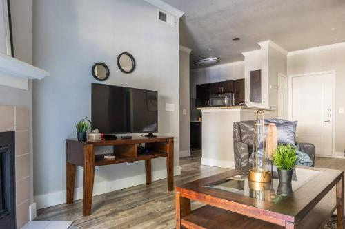 A television and/or entertainment center at Quiet + Modern | Parking | Dining + Shopping 2BR