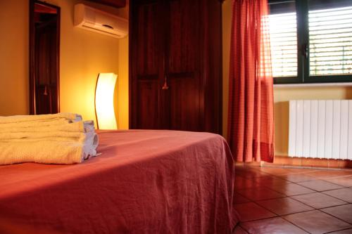 A bed or beds in a room at B&B Porta Bagni
