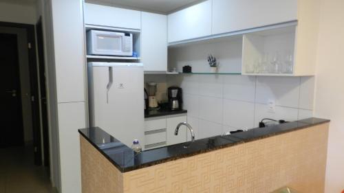 A kitchen or kitchenette at Flat Acolhedor 2 Qtos Boa Viagem