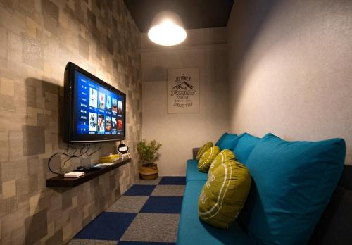 A television and/or entertainment center at Vibrant Hostel
