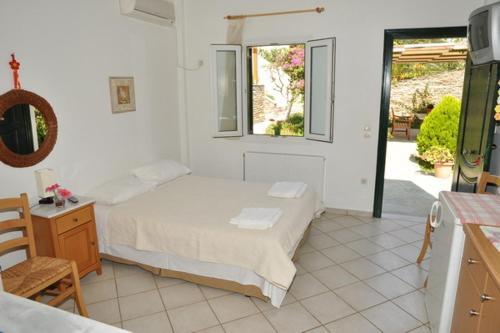 Ένα ή περισσότερα κρεβάτια σε δωμάτιο στο Handakas Studios