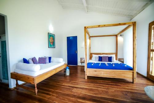 A bed or beds in a room at Amanta Beach