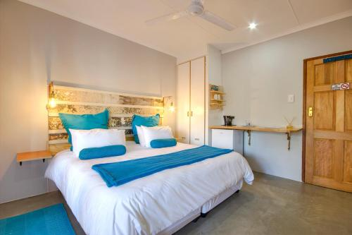 A bed or beds in a room at Marlin Lodge St Lucia