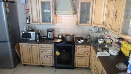 Кухня или мини-кухня в Гостевой дом Чистый берег
