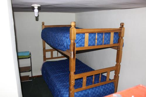 A bunk bed or bunk beds in a room at Hostel Climbing Point