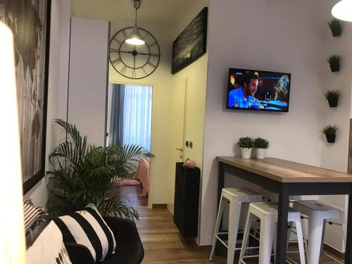 A television and/or entertainment centre at Center Arena Design Apartments with terrace