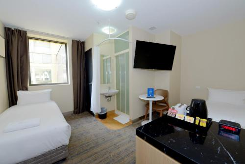 A television and/or entertainment center at ibis Budget - Melbourne CBD