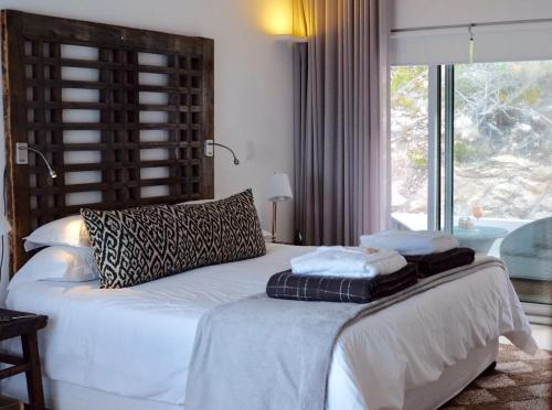 A bed or beds in a room at Agulhas Ocean House
