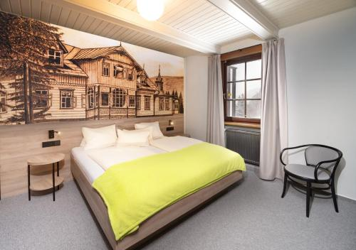 A bed or beds in a room at Hotel Start