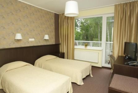 Voodi või voodid majutusasutuse Pühajärve Spa & Holiday Resort toas