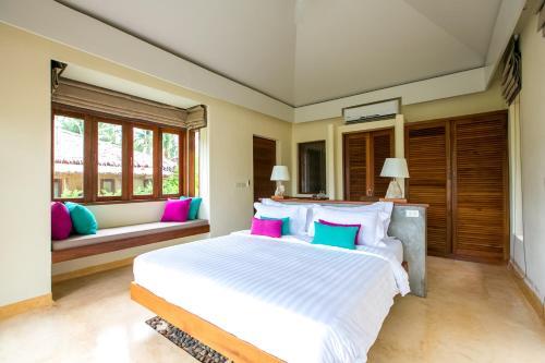 En eller flere senge i et værelse på Sea Dance Resort