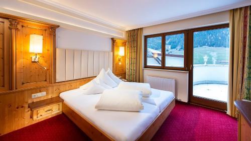 Ein Bett oder Betten in einem Zimmer der Unterkunft Alpvita Piz Tasna