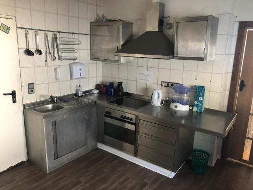 A kitchen or kitchenette at Pension Lume