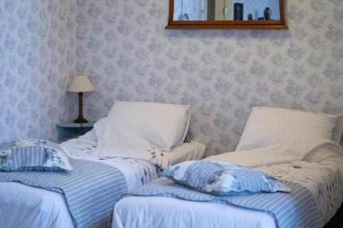 Een bed of bedden in een kamer bij BenB Groningen