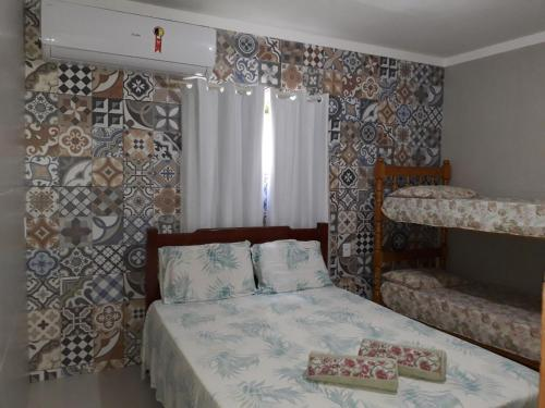 A bed or beds in a room at Pousada Nativo