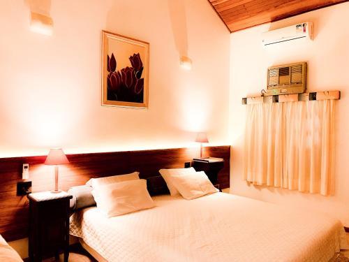 Cama ou camas em um quarto em Parque Hotel Holambra