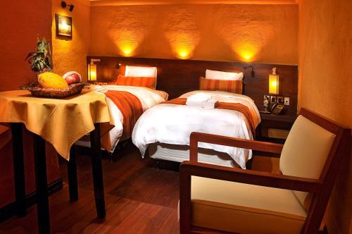 Una cama o camas en una habitación de Hotel Jardines de Uyuni