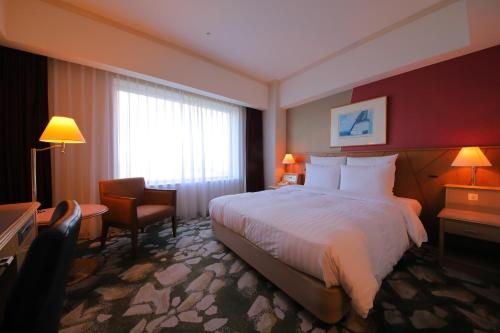 A bed or beds in a room at Surfeel Hotel Wakkanai