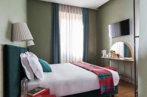 Un ou plusieurs lits dans un hébergement de l'établissement Condominio Monti Boutique Hotel