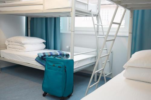A bunk bed or bunk beds in a room at RixHouse Hostel