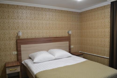 Кровать или кровати в номере Гостиница Визит