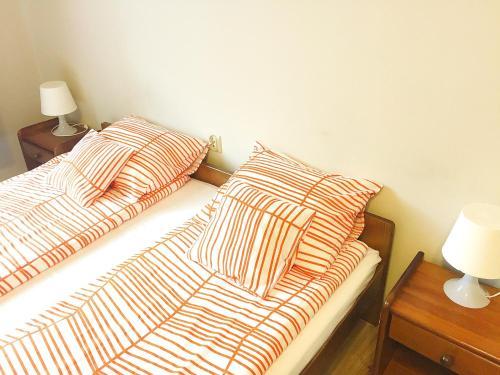 Cama o camas de una habitación en Pokoje Krowoderska