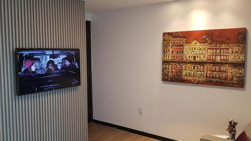 A television and/or entertainment centre at FLAT 1808 RECIFE