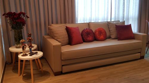 A seating area at FLAT 1808 RECIFE