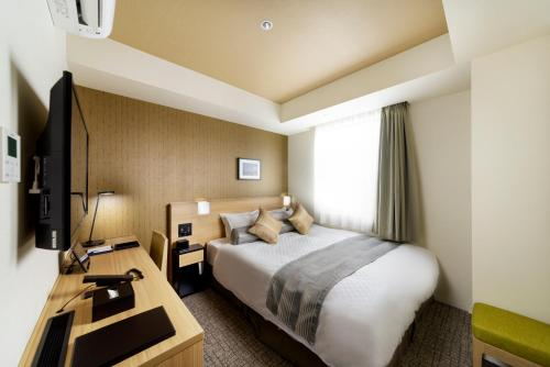 A bed or beds in a room at Best Western Hotel Fino Tokyo Akihabara