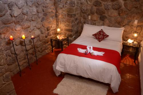 Cama o camas de una habitación en Rumi Wasi