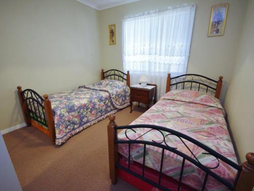 A bed or beds in a room at Fravent House