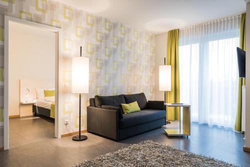 Ein Sitzbereich in der Unterkunft Hotel & Restaurant Michaelis