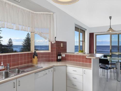 A kitchen or kitchenette at Stunning Toowoon Bay on Charlton