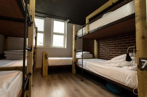 A bunk bed or bunk beds in a room at The Nest Boutique Hostel