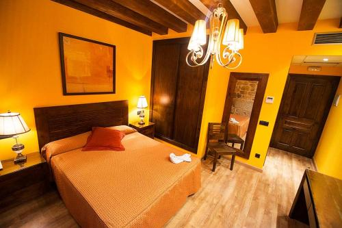 Cama o camas de una habitación en Posada Doña Urraca