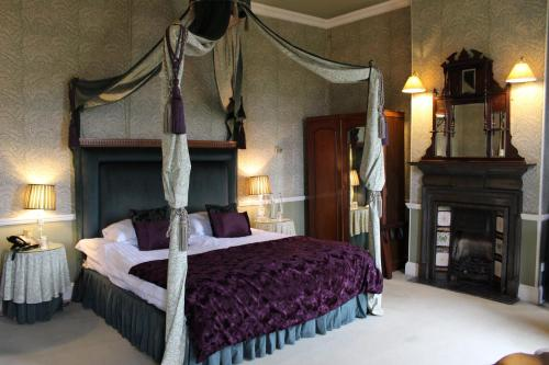 A bed or beds in a room at Grafton Manor Hotel