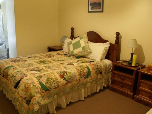 A bed or beds in a room at Portee Homestead